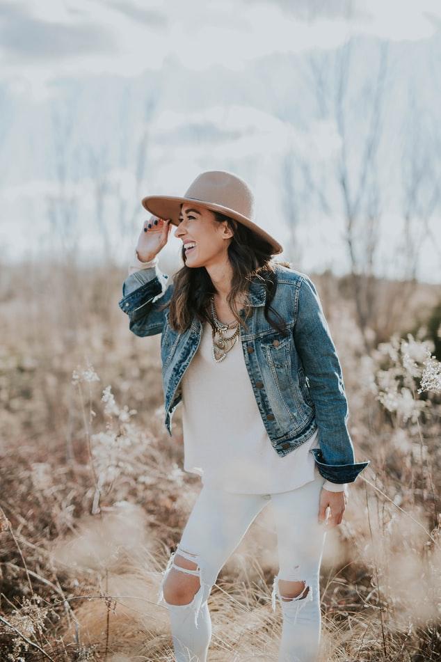 Girl in hat in field